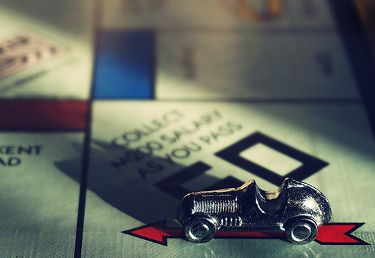 Close up of a monopoly board with model car